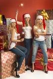 Three gorgeous women holding sparklers Royalty Free Stock Photo