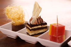 Three gourmet desserts Stock Images