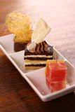 Three gourmet desserts Stock Image