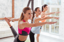 Three graceful women having group stretching classes Stock Image