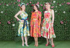 Three Graces. Three beautiful women in colorful dresses in summer evening royalty free stock photo