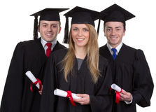 Three graduate with scrolls against a white background Royalty Free Stock Photo