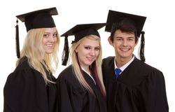 Three graduates Stock Images