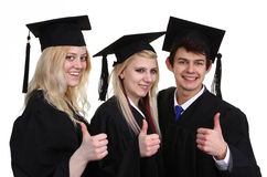 Three graduates Royalty Free Stock Photos