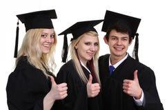 Three graduates Royalty Free Stock Photos