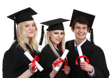 Three graduates holding scrolls Royalty Free Stock Photo