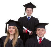 Three graduates in a triangle formation, isolated on white Stock Photography