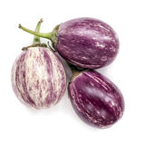 Three graffiti eggplants on white stock photography
