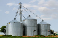 Three grain elevators Stock Images