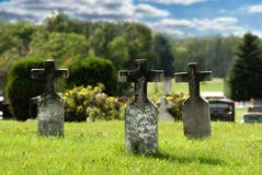 Three Graves. With crosses situated in a small graveyard, done in vibrant colors to signify peace Stock Photography