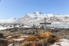 Three graves. Abandoned cemetery in Qoornoq - former fishermen v Stock Photo