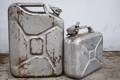 Two gray cans with gasoline or diesel, metal barrel royalty free stock photo