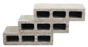 Isolated Construction Blocks - Three. Three gray concrete construction blocks (a.k.a. cinder block, breeze block, cement block, foundation block, besser block Royalty Free Stock Photos
