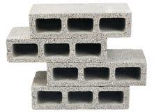 Isolated Construction Blocks - Three. Three gray concrete construction blocks (a.k.a. cinder block, breeze block, cement block, foundation block, besser block Royalty Free Stock Images