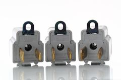 Three gray electrical outlet plugin converters Royalty Free Stock Photography