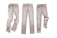Three gray jeans Stock Images