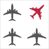 Three gray passenger planes and one red. Isolated on white background. Silhouette can be used for icons or emblems. Vector illustration for flight and aviation Stock Photos