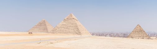 The Great Pyramids of ancient Egypt. Three Great Pyramids of Egypt in one photo, Giza plateau. From left to right the Pyramid of Khufu, the somewhat smaller royalty free stock images