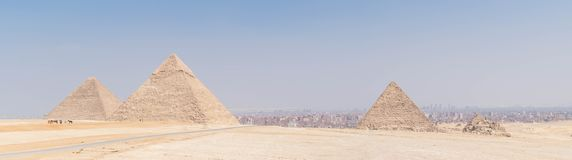 The Great Pyramids of ancient Egypt. Three Great Pyramids of Egypt in one photo, Giza plateau. From left to right the Pyramid of Khufu, the somewhat smaller stock image