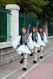 Three Greek guards marching in national costumes. Three Greek guards marching in the national costumes of the park in Athens Stock Photo