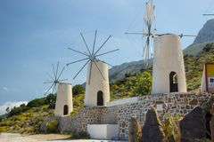 Three Greek Windmills on the mountain. The windmills are white and of old look stock photos