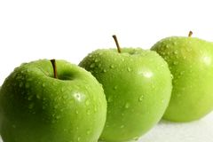 Three green apple. Isolated on white Royalty Free Stock Photo