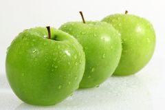 Three green apple Stock Photos