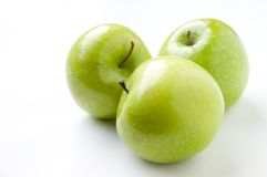 Three green apples. On white royalty free stock images