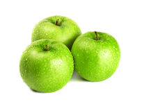 Three green apples Stock Photos