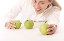 Three green apples 2. Stock photo of a young woman with green apples, healthy food royalty free stock photos