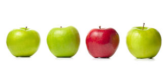 Three Green Apples And One Red Royalty Free Stock Photos