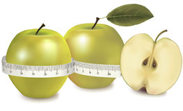 Three green apples measured the meter. Stock Photography