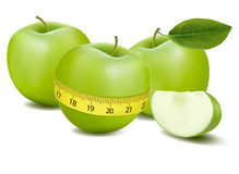 Three green apples measured the meter. Royalty Free Stock Images