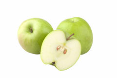 Three green apples one cut. Closeup studio photo of  three apples  nice and juicy one cut half  isolated on white background Royalty Free Stock Images