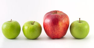 Three green apples and one red. On white Royalty Free Stock Photo
