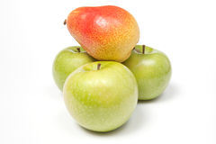 Three green apples and a pear Royalty Free Stock Photo