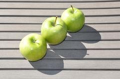 Three green apples. With shadows Stock Image