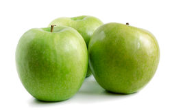 Three green apples on a white background. Stock Image