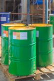 Three green barrels with label Poison on wooden pallets. Three green barrels with label Poison standing on wooden pallets on a chemical plant royalty free stock image