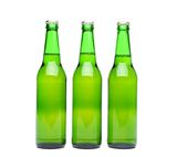 Three green beer bottle. With drops drink without label on a white background Stock Photos