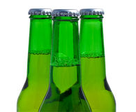 Three green beer bottles Royalty Free Stock Photos