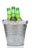 Three Green Beer Bottles in Ice Stock Photography