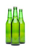 Three green beer bottles. Stock Images