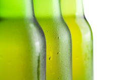 Three green beer bottles on the white Stock Photos