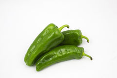 Three green bell peppers Stock Photos