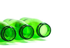 Three Green Bottles Lay Down on White Background. With focus on center bottle, Copy Space Above Stock Photos