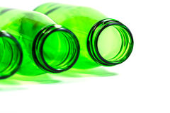 Three Green Bottles Lay Down on White Background. With focus on Right bottle, Copy Space Below Stock Images