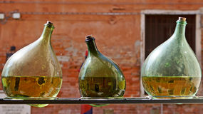 Three green bottles with reflection of Venice, Italy Stock Photos