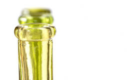 Three green bottles on white Royalty Free Stock Images