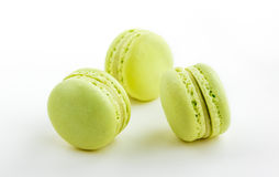 Three green cake macaron  on white background, maccarone sweet dessert Royalty Free Stock Photos